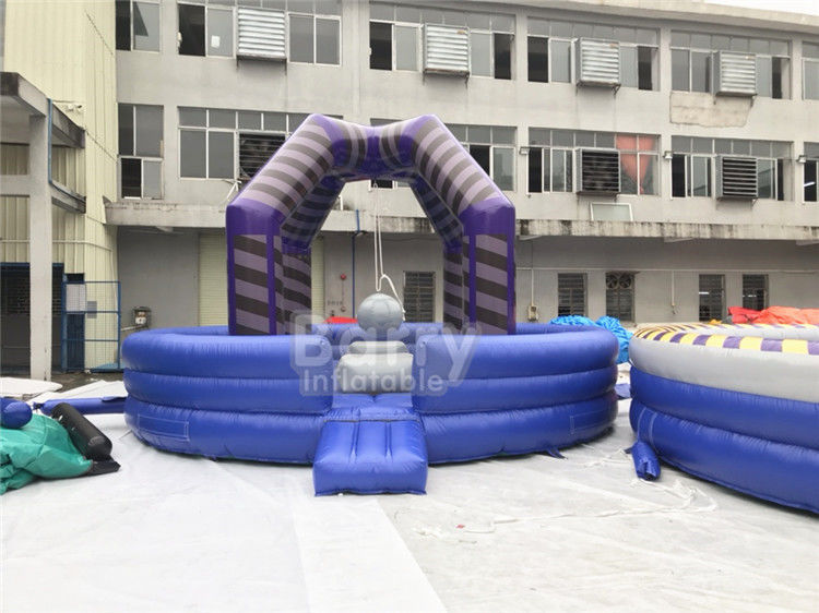 Cina Last Man Standing Inflatable Interactive Games, Purple Outdoor Playground Equipment Wrecking Ball Game pabrik