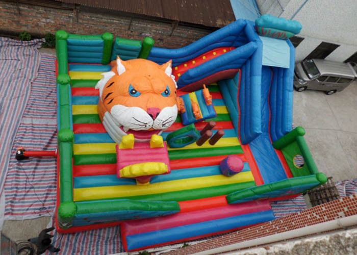 Cina Hiburan Tiger Head childrens Inflatable Bouncy Castle Dengan Slide pabrik
